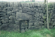 Click to enlarge image of possible re-used cross base in sheep hole of stone wall